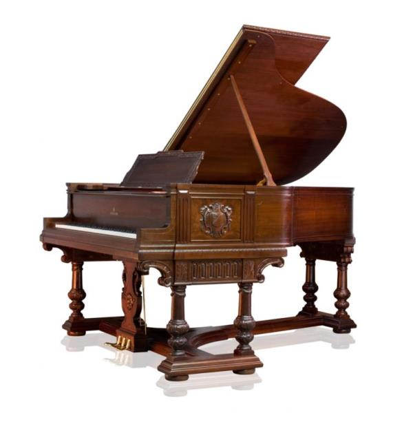 Steinway A grand piano in the in a carved mahogany Jacobean style case on six heavy baluster