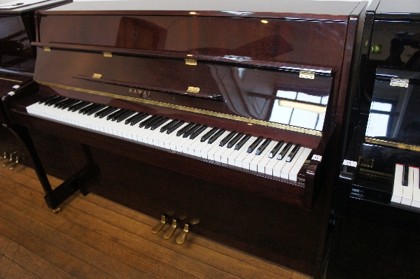 Lot 13 - Kawai No 21426 (c2000)  A Model KX10 upright piano in a bright mahogany case