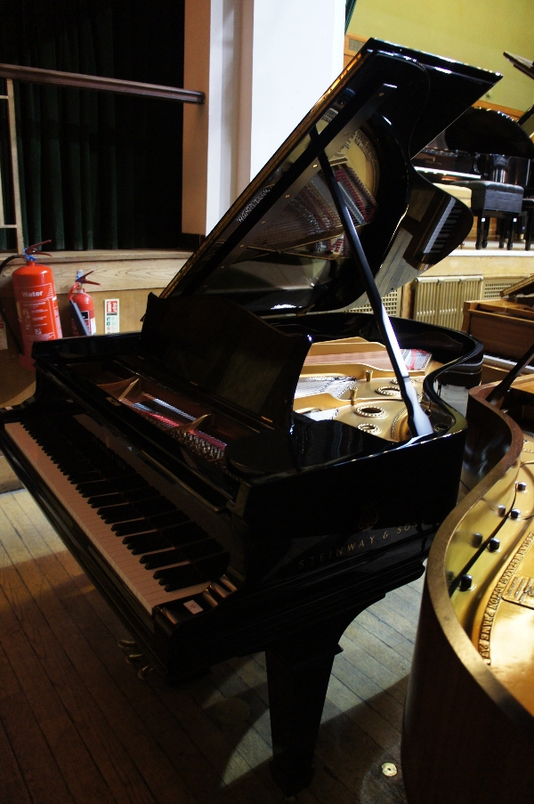 Lot 17 - Steinway (c1907) A 6ft 2in Model A grand piano in a bright ebonised case on square tapered legs.