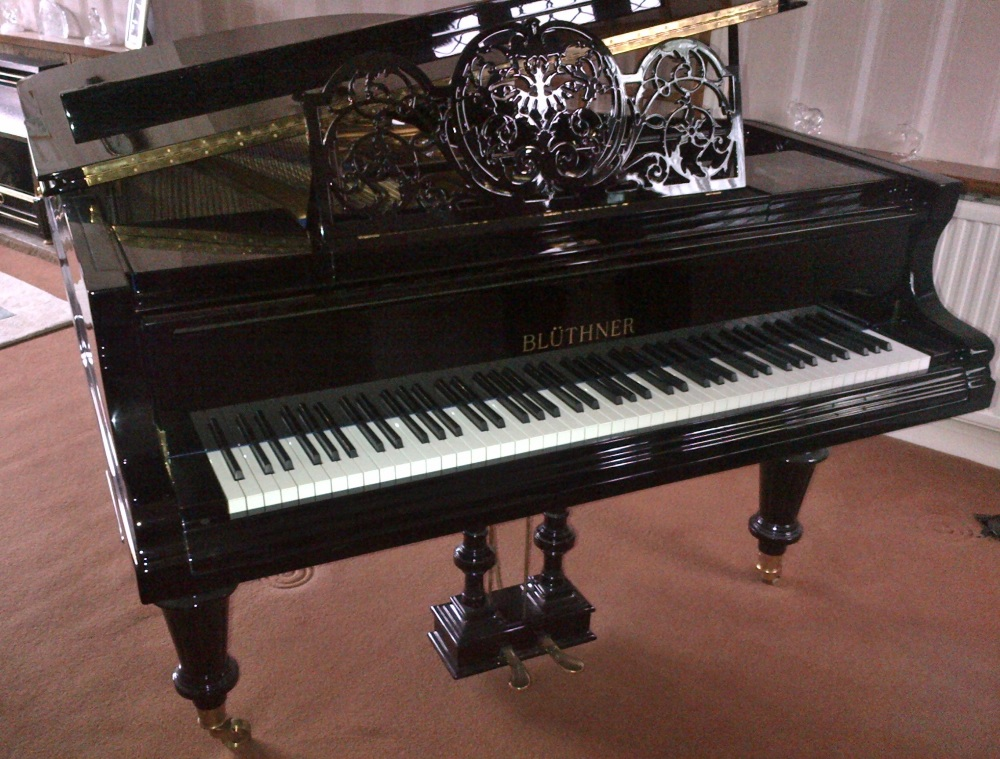 Lot 22 - Blüthner (c1900)  A 6ft 3in grand piano in a bright ebonised case on turned legs. This piano has