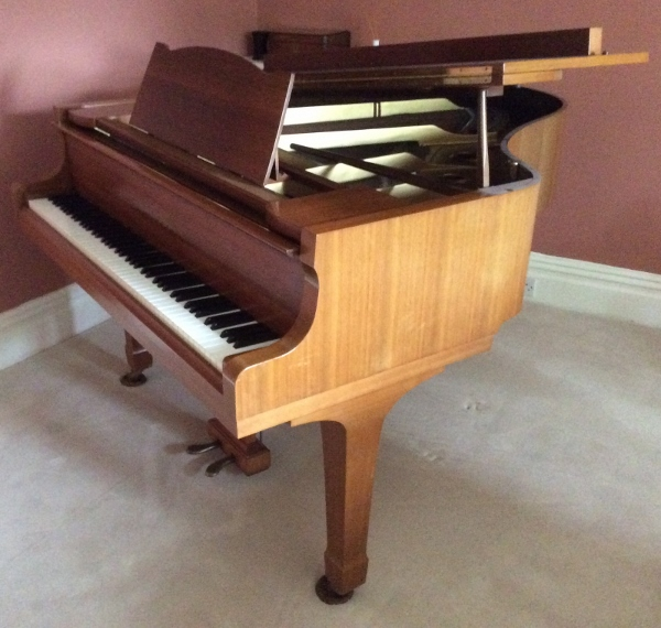 Lot 26 - Yamaha (c1971) A 5ft 7in Model G2 grand piano in a bright mahogany case on square tapered legs.