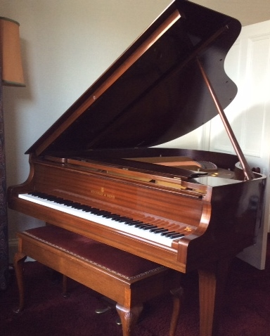 Lot 28 - Steinway (c1959) A 5ft 7in Model M grand piano in a mahogany case on square tapered legs, together