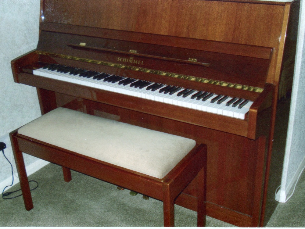 Lot 31 - Schimmel (c1988) A Model 112 upright piano in a bright walnut case, together with a duet stool.