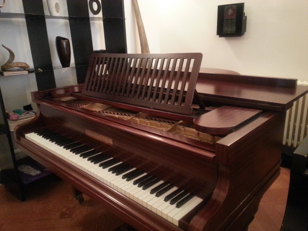 Lot 32 - Bechstein  A 6ft Model A grand piano in a re-polished mahogany case on square tapered legs.