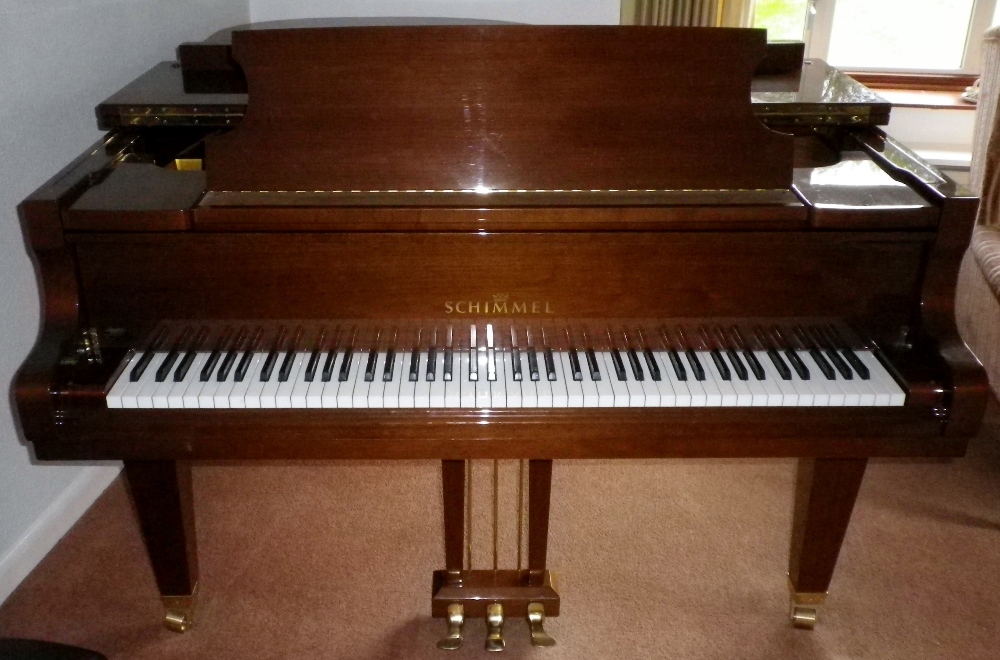 Lot 33 - Schimmel (c1989)  A 5ft 9in Model 174T grand piano in a bright walnut case on square tapered legs,
