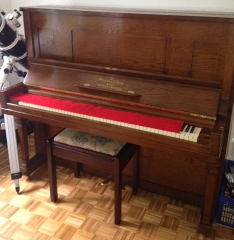 Lot 37 - Steinway   An upright piano in an oak case.