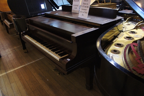 Lot 39 - * Steinway A 6ft 8in Model O ex-pianola grand piano in a rosewood case on square tapered legs.
