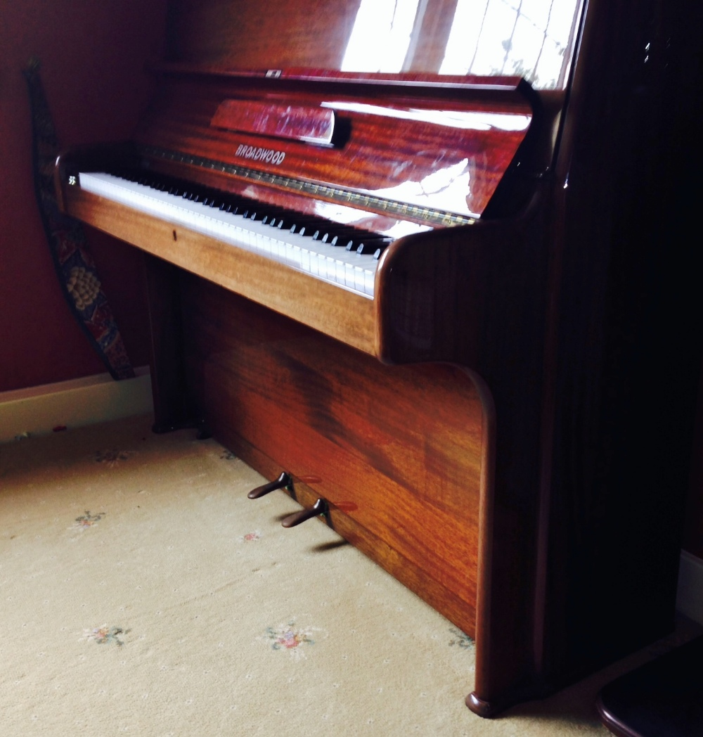 Lot 48 - Broadwood (c1978)  A modern style upright piano in a bright mahogany case; together with the 250