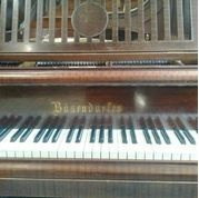 Lot 49 - Bösendorfer (c1937)  A 5ft 8in grand piano in a mahogany case on square tapered  legs.  AMENDMENT