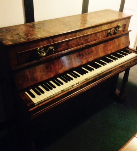 Lot 52 - A Bord, Paris (c1860) A cottage upright piano in a burr walnut case; fitted with brass candle scones