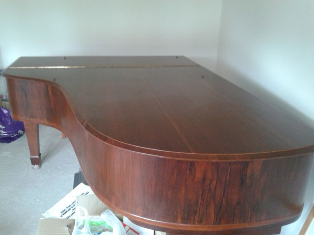 Lot 8 - Steinway (c1913)  A 6ft 11in Model B grand piano in a rosewood case on square tapered legs. This