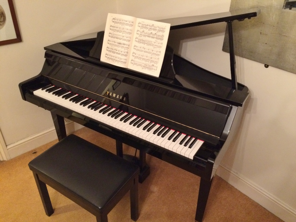 Lot 92 - Yamaha (c1999) A 3ft Model GT2 Grand Touch digital piano in a bright ebonised case, together with
