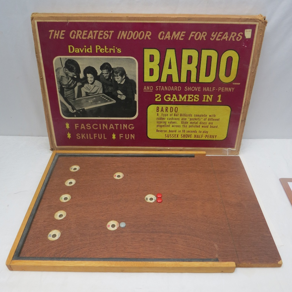 A board for the game of ``Bardo and Sussex Shove Half-Penny`` as retailed by Harrods, within