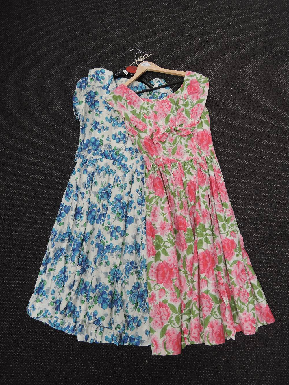 Two ladies vintage floral summer dresses in shades of blue and pink by Benhams, London and