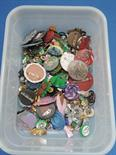 A collection of pin badges and home made brooches