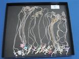 A selection of white metal fashion pendants including Tinkerbell fairies and teddies
