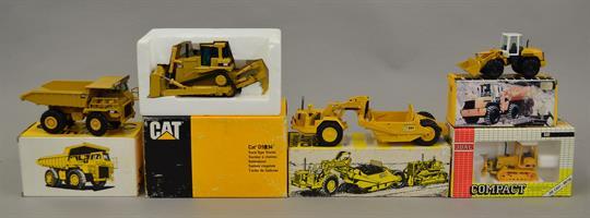 Five die-cast construction vehicles: Conrad Liebherr Wheel Loader