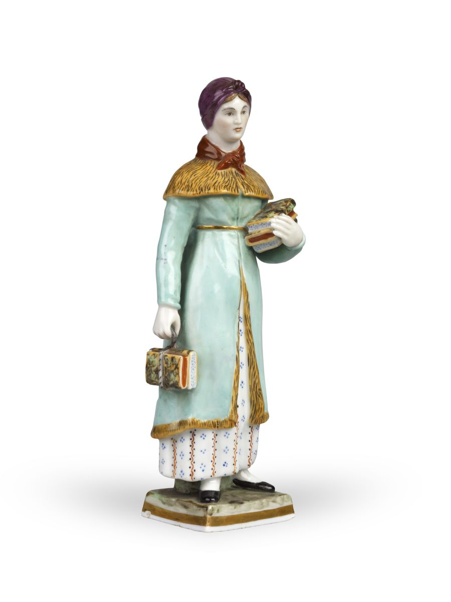 * A PORCELAIN FIGURINE OF A GOVERNESS  GARDNER MANUFACTORY, MOSCOW, LATE 1810–1820s Height 17.5