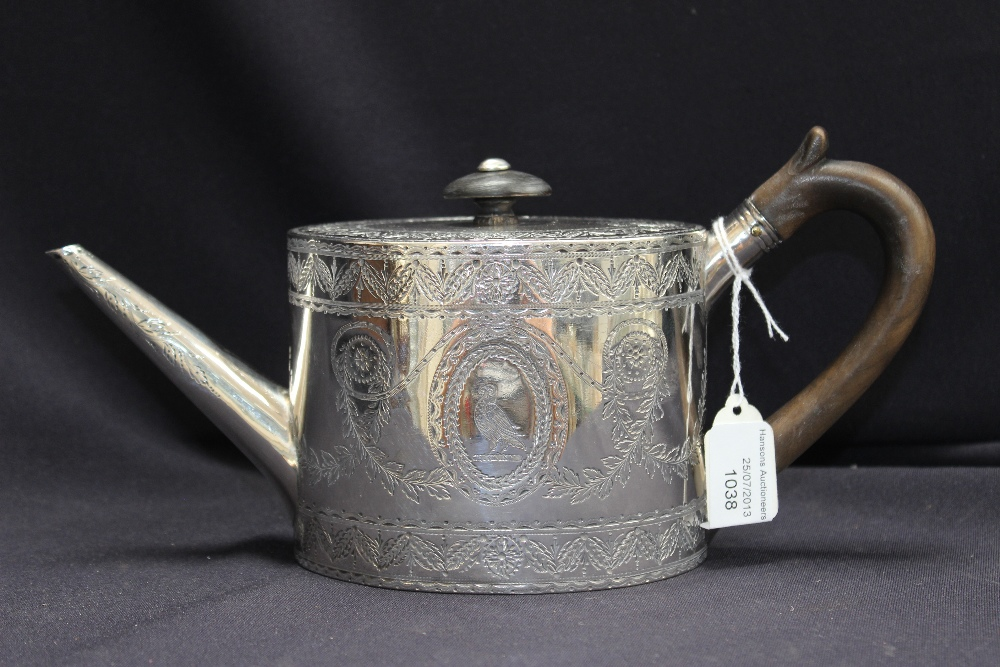 A George Iii Silver Oval Teapot And Cover In Neoclassical