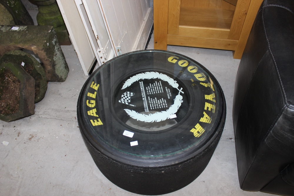 an f1 tyre coffee table 1993 season glass top with good year tyre