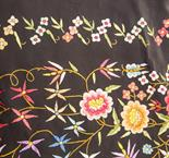 An Art Deco richly embroidered shawl, colourful flowers on a black ground