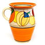 A Clarice Cliff Melon pattern Tolphin jug, circa 1930, painted with a deep band of geometric fruit