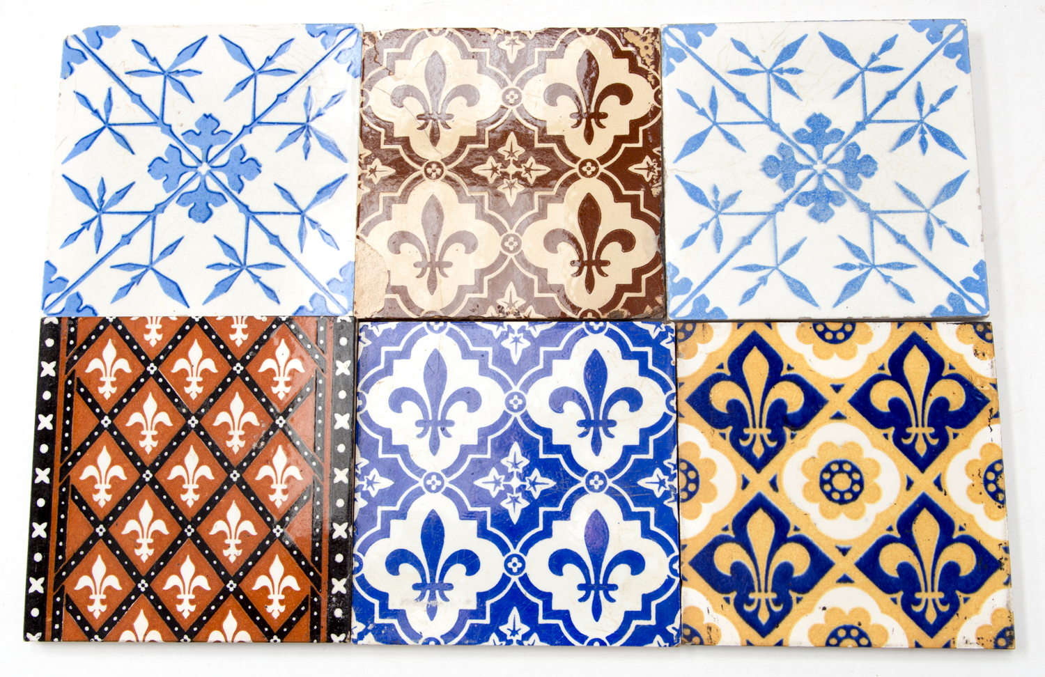 Six Victorian tiles attributed to A W N Pugin, most by Minton and Minton, Hollins & Co., decorated