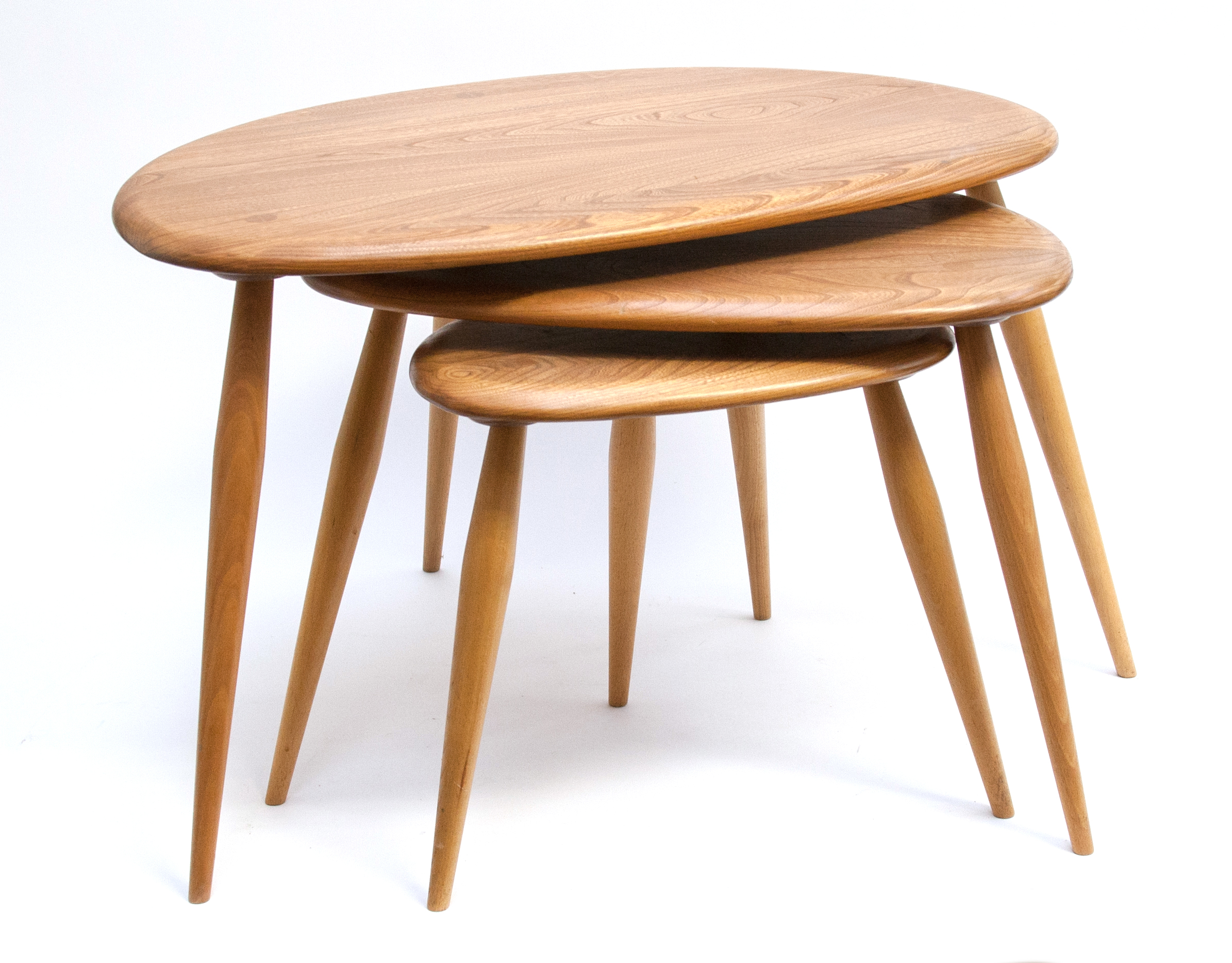 Lot 302 - A nest of Ercol pebble tables, light elm and ash, 40cm high, 65cm wide