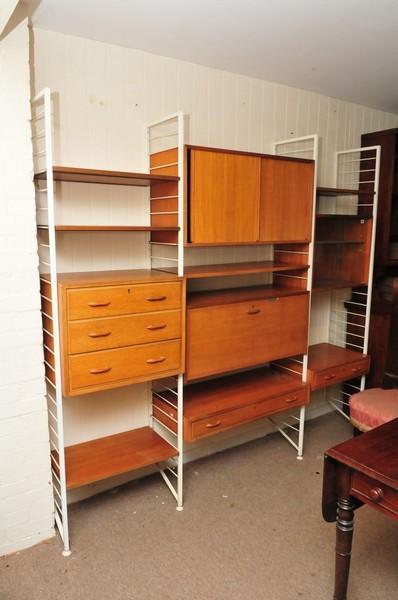 A modern design teak lader wall cabinet, makers staples Ladderax.