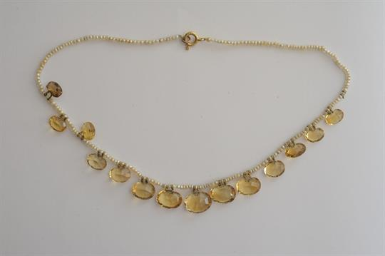 23f52c258 An antique single strand drilled seed pearl necklace with faceted ...