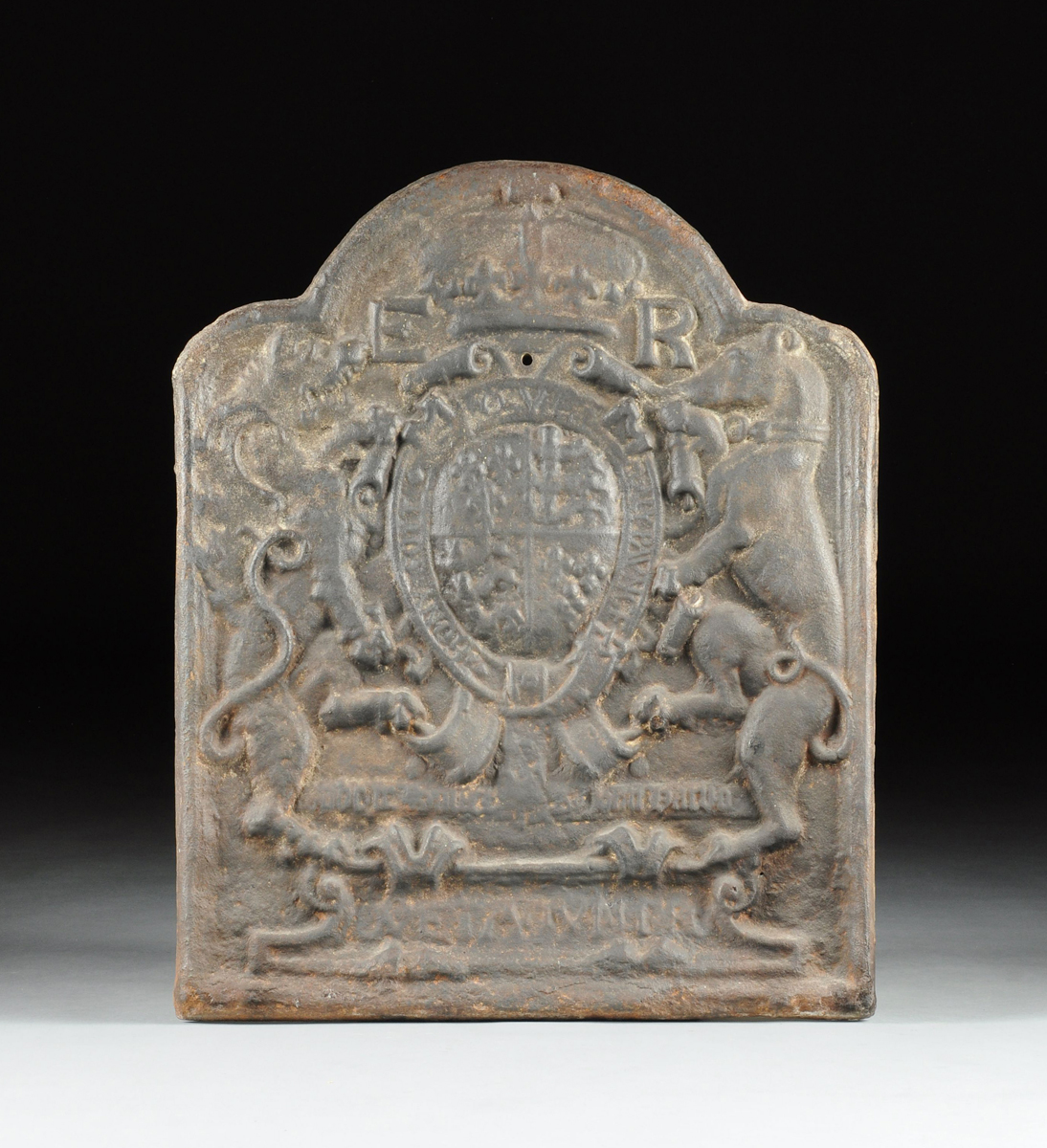 AN ENGLISH ELIZABETHAN STYLE ARMORIAL CAST IRON FIREPLACE BACK ...