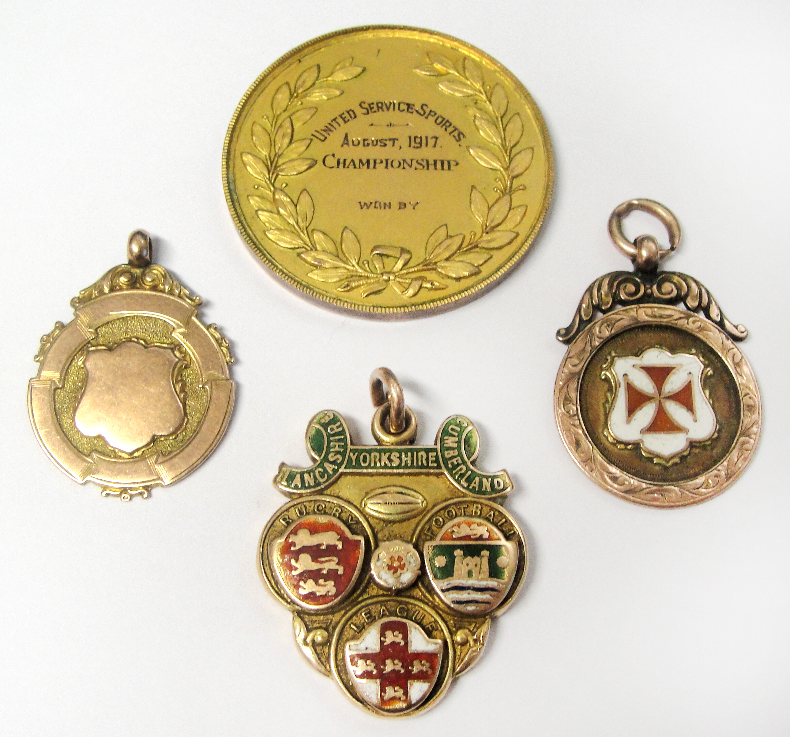 Lot 26 - A rare collection of Rugby League medals awarded to Harold Buck, comprising a 15ct gold and enamel