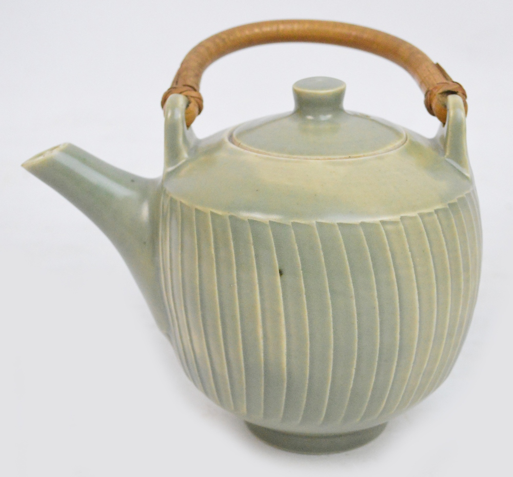 Lot 277 - DAVID LEACH (1911-2005) for Lowerdown Pottery; a porcelain fluted teapot with cane handle covered in