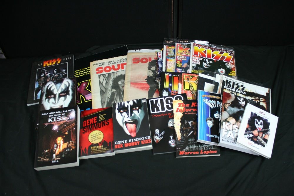 Lot 107 - KISS - collection of 10 x books and several magazines to include `Kiss Faq`, `Gene Simmons Glam