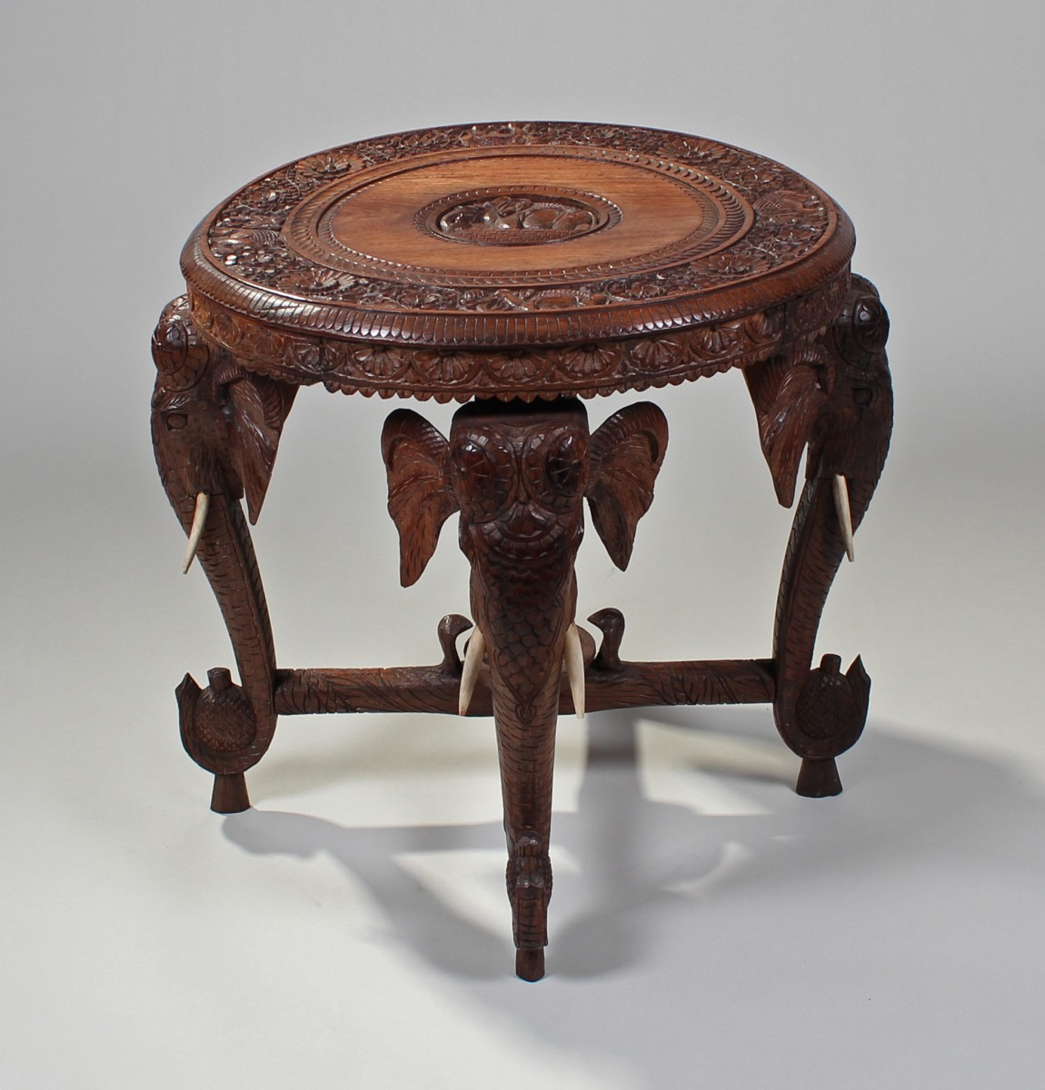 Lot 801   Indian Carved Elephant Table, The Circular Carved Top Above  Elephant Carved Legs