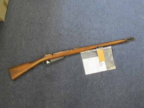 Rifle: Chinese Model 1888 Commission Mauser rifle cal 7 92  The oval