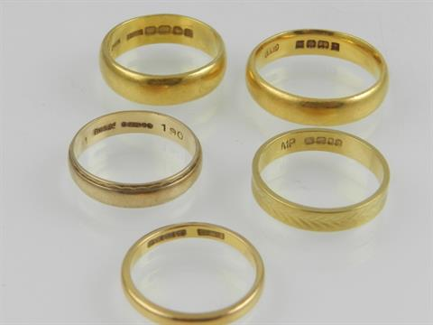 Three 22 carat yellow gold wedding bands an 18 carat gold wedding