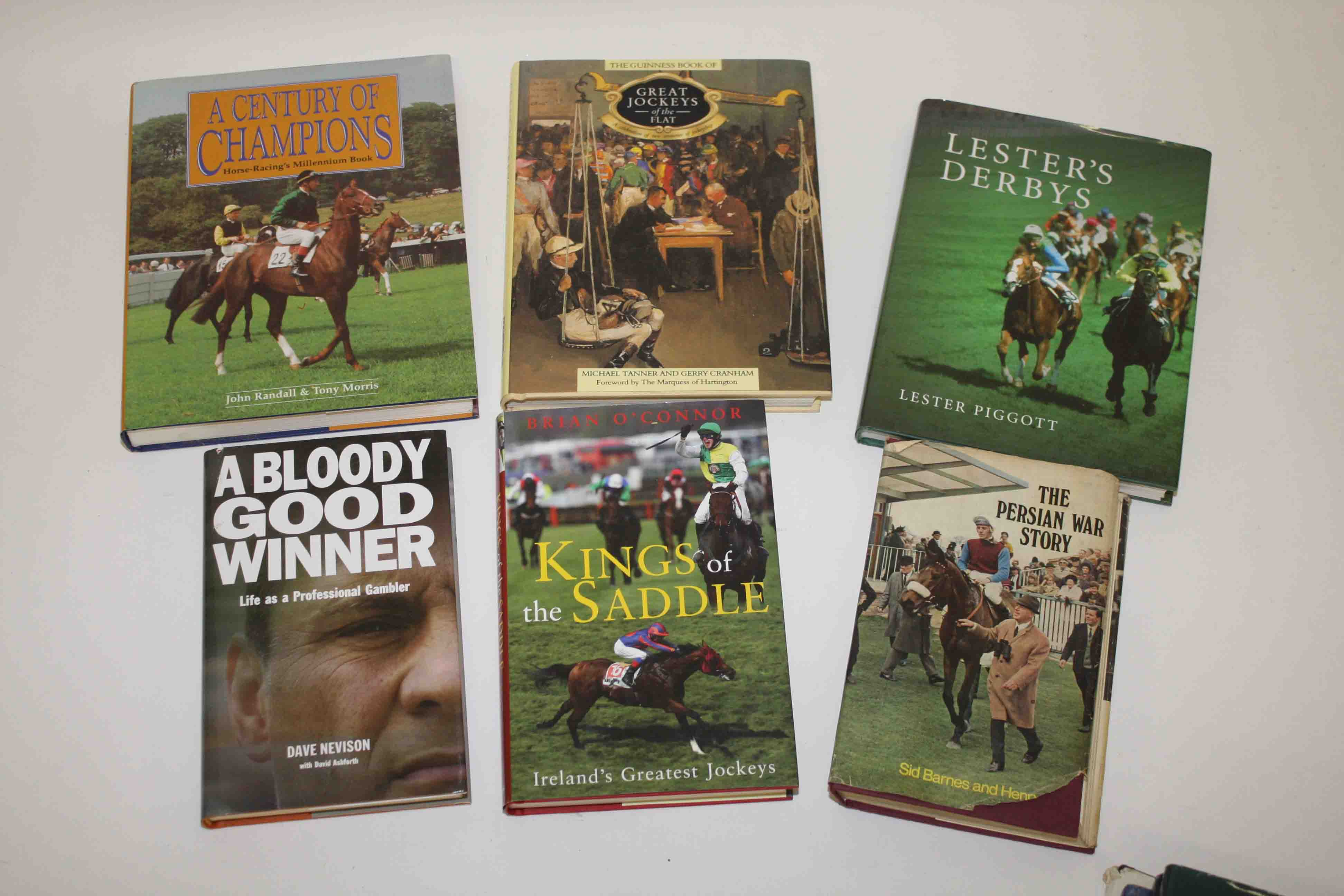 A COLLECTION OF COFFEE TABLE BOOKS RELATED TO HORSE RACING