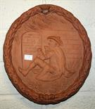 A 19TH CENTURY UNUSUAL OVAL TERRACOTTA HOME RULE PLAQUE,  relief moulded with a man in tail coat and