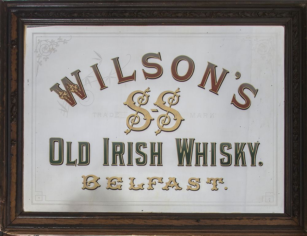 AN ANTIQUE PUB ADVERTISING MIRROR,  for Wilson's Old Irish Whiskey Belfast, etched with Shamrock