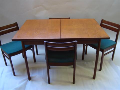White Newton Of Portsmouth Ltd A 1960s Extending Dining Table And Four Chairs