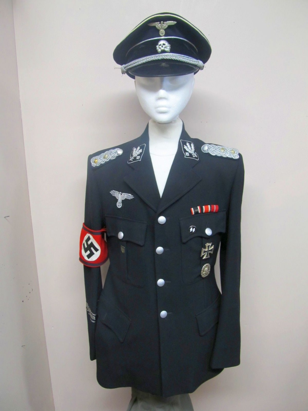 A modern copy of a Gestapo uniform to include hat ...