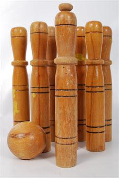 A Set Of Vintage Bar Skittles With Turned Wooden Shafts Along With