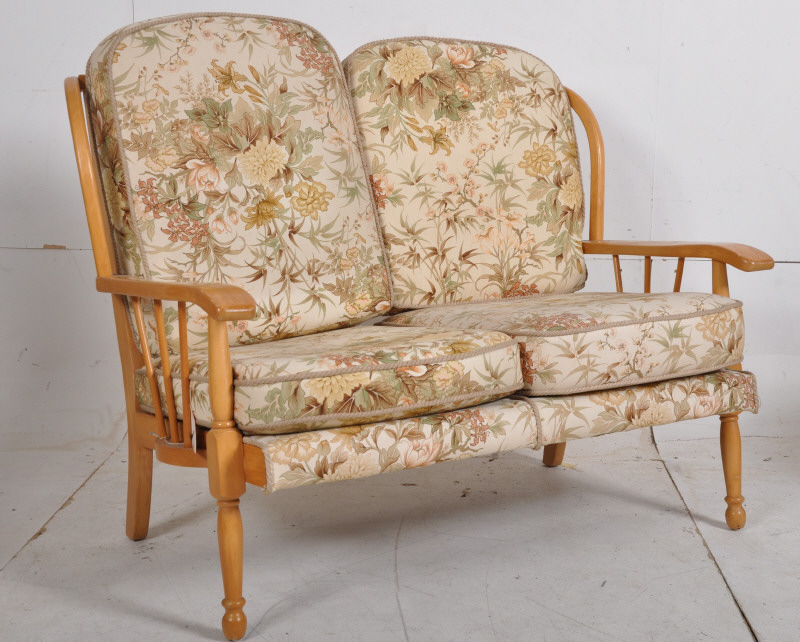 Lot 279 An Ercol Style Sofa In Beechwood Spindle Back Frame On Turned Legs