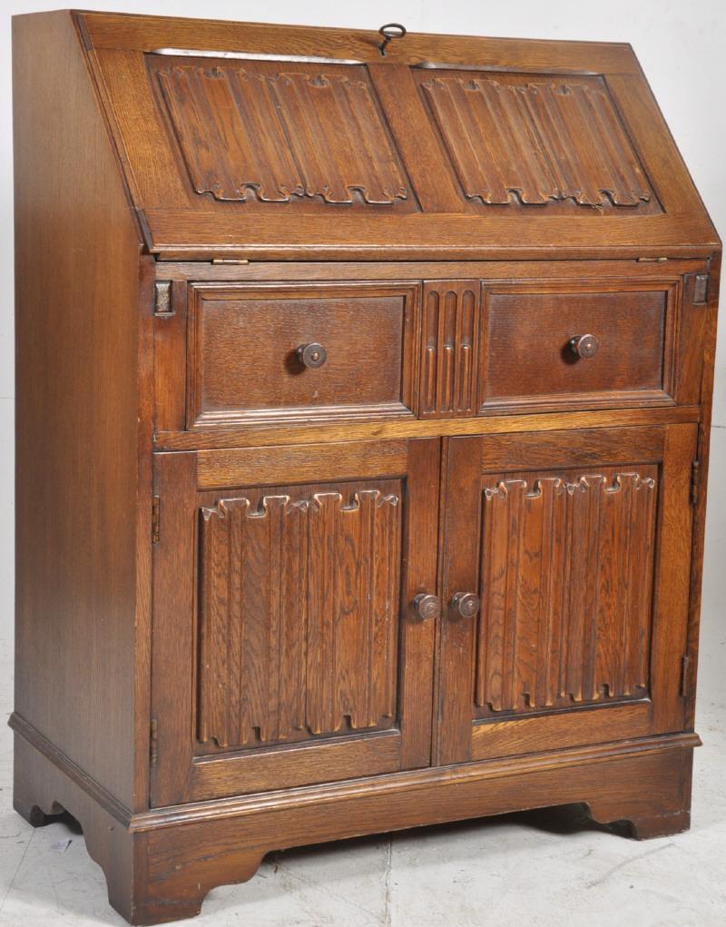 A good Jaycee oak writing desk bureau in the Jacobean style The