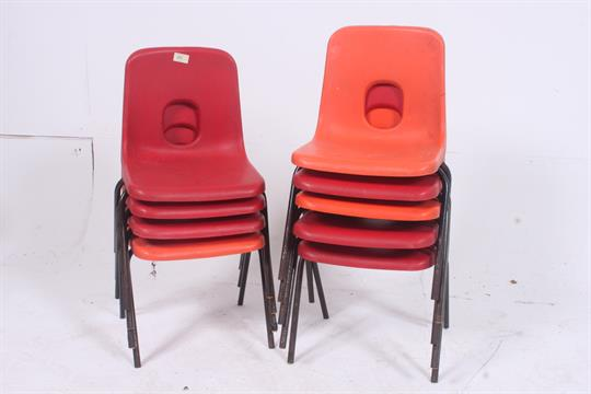 a collection of 9 vintage retro hille plastic school chairs in both red and orange each supporte t49 plastic