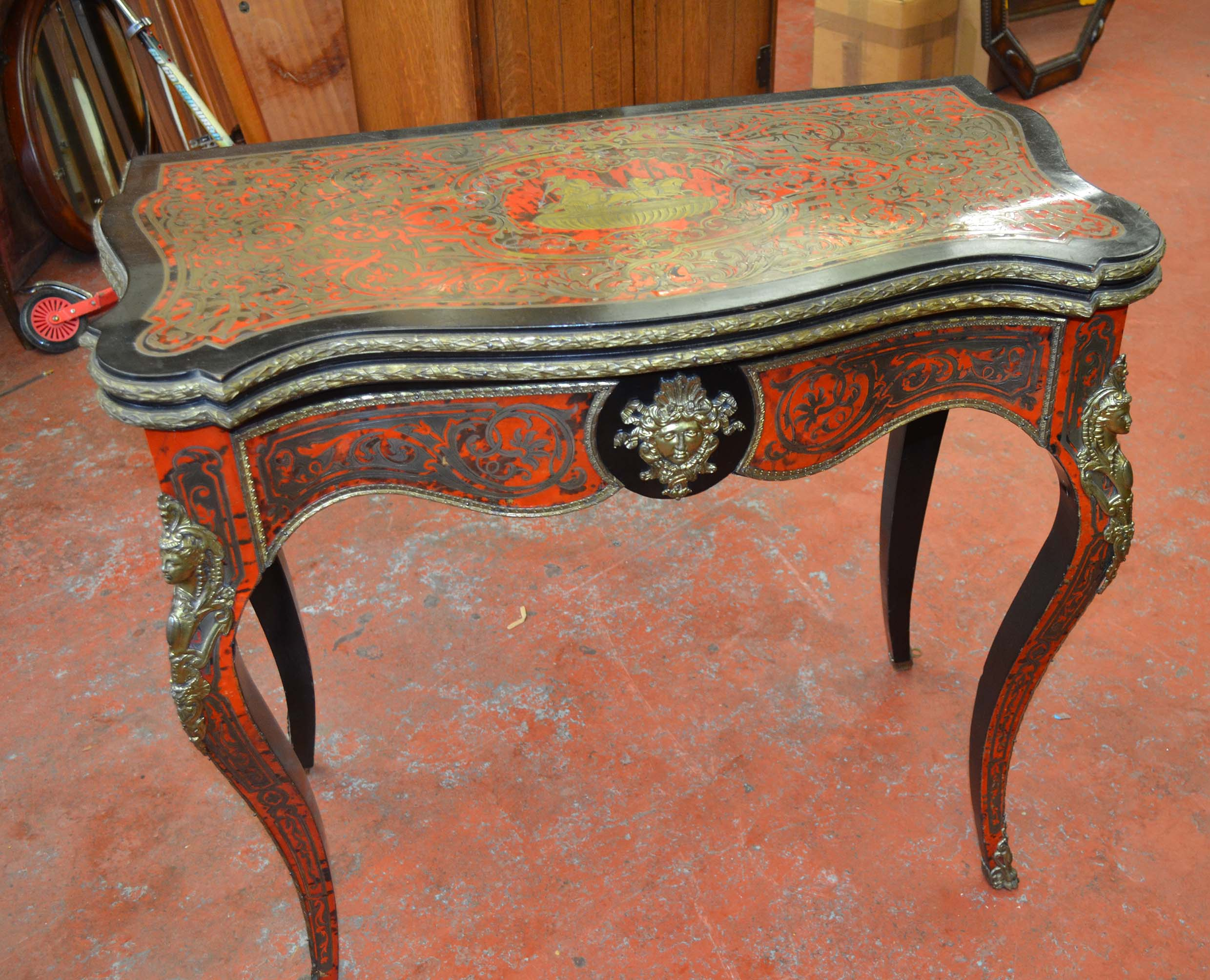 Lot 550   Circa 19th Century French Ebonised Serpentine Card Table With  Boule Work Top.