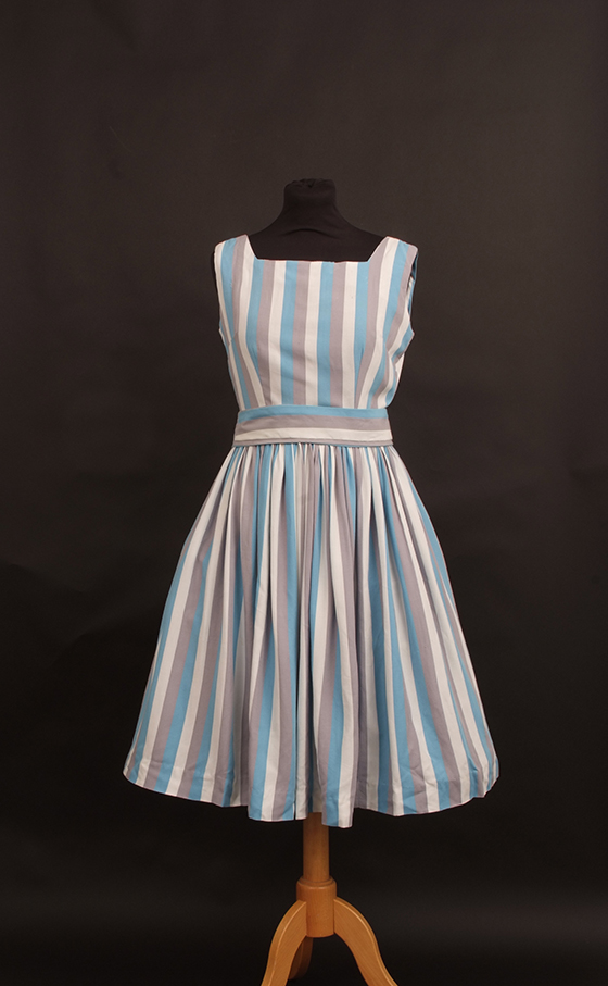 Four 1950's floral summer dresses.   To include A yellow brocade fitted, high waisted dress with