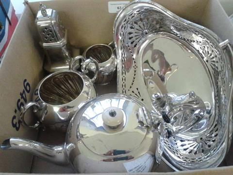 A box of silver plate items to include teapot, milk jug and