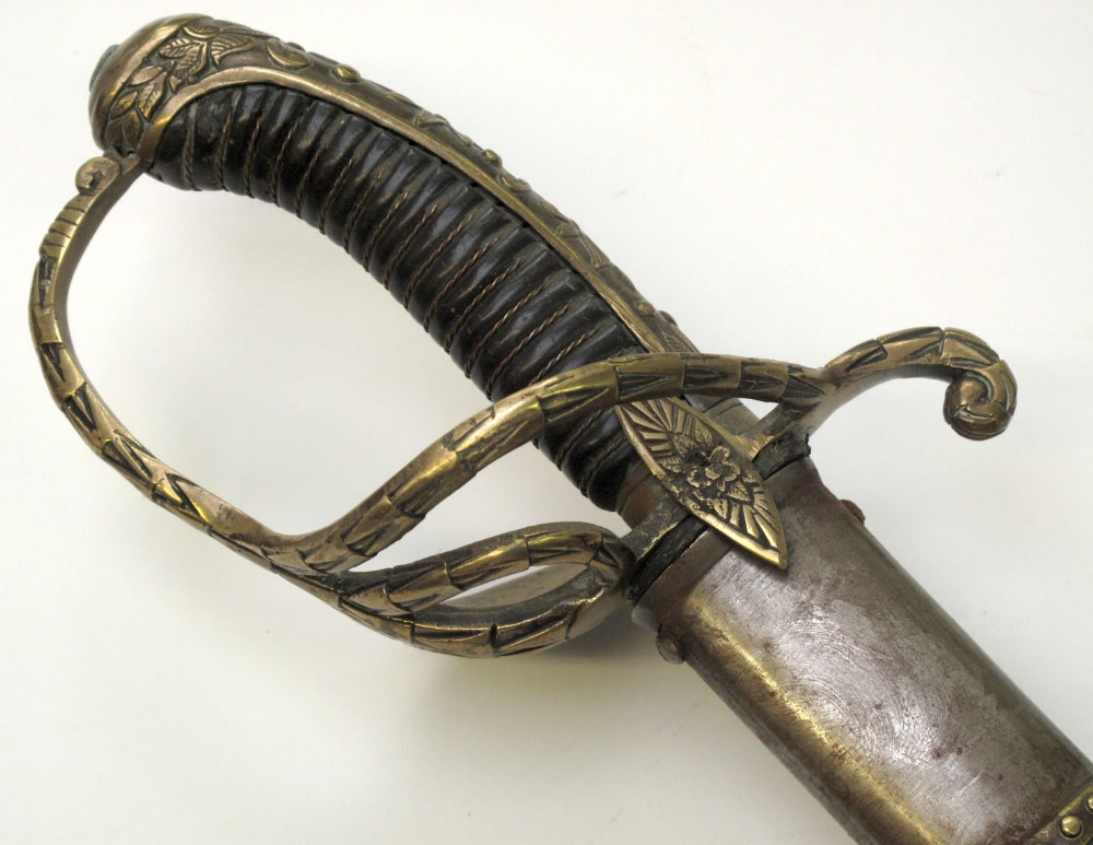 French Gendarmerie Royale Sword with brass two bar and dish back hilt. Decorated floral back strap.